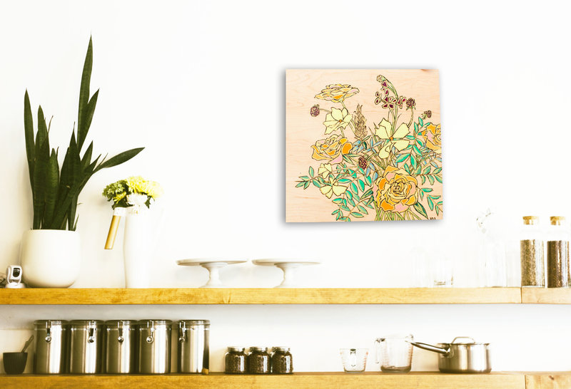 bright orange wood burned square bouquet above wooden shelf