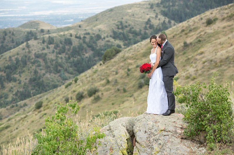 Colorado mountain wedding photographer - Kali & Yates looking out over the mountains in Golden CO