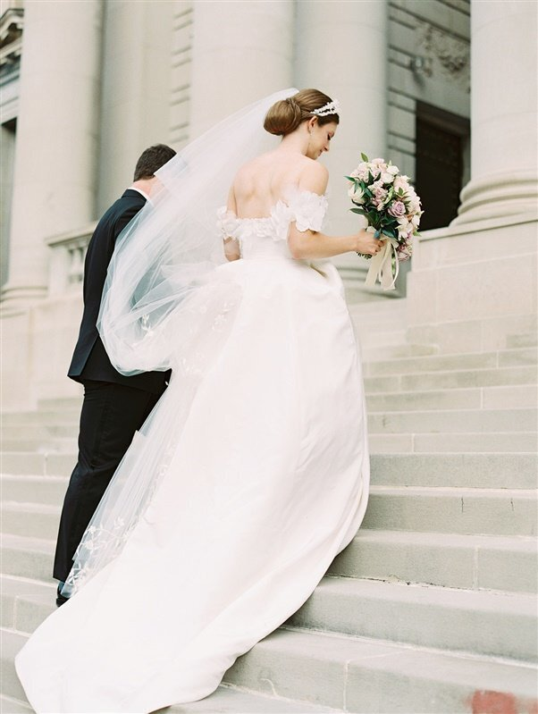 bride-groom-walking-up-steps-immaculate-conception-bonnie-sen-photography