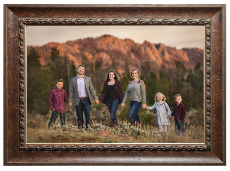 Family wearing burgundy and grey near Laramie with the mountains at sunset.