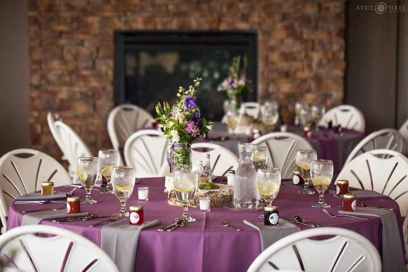 Lower level of Pines of Genesee set up for purple colored wedding reception