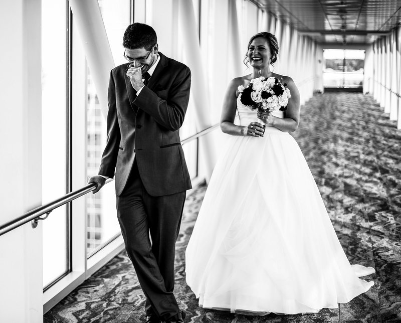 Groom anxiously waiting for his bride on the skybridge at the Sheraton Erie Bayfront Hotel