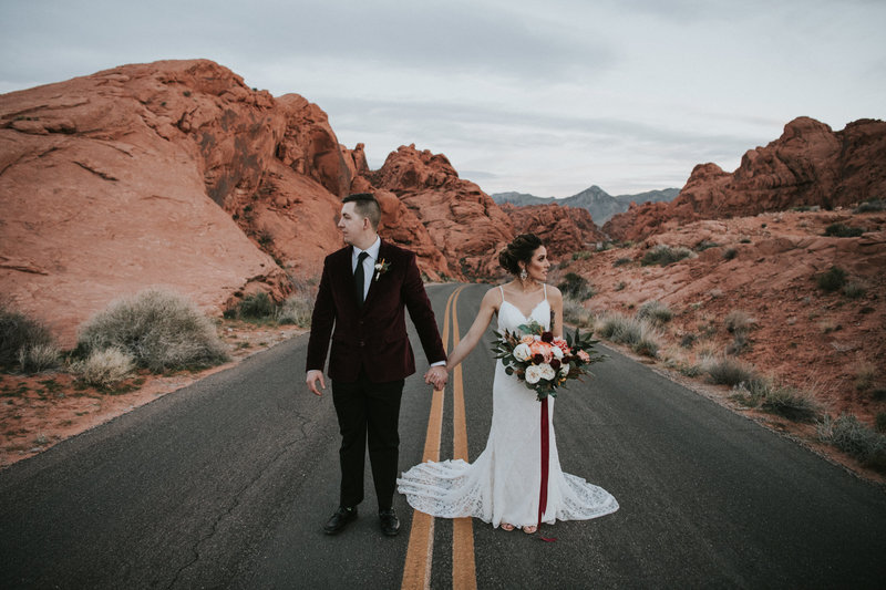 bride & groom standing in road