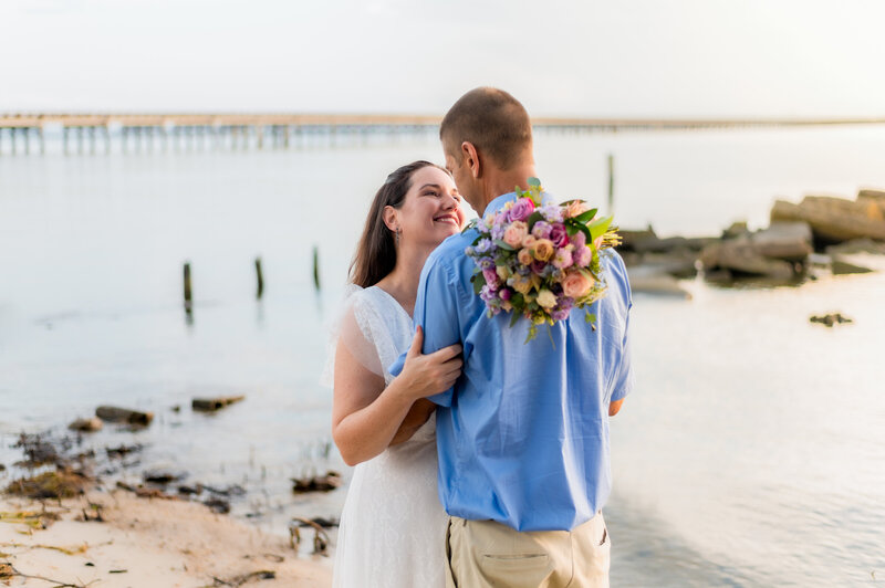 wedding couple by the water in manteo, nc