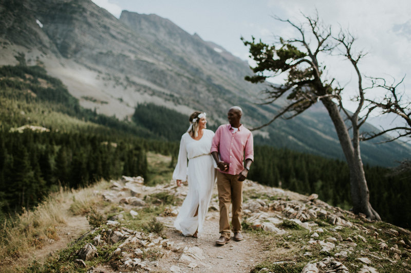 Many Glacier MT Elopement Couple Holding Hands Laughing