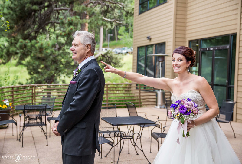 Bride shows her dad her dress at The Pines at Genesee