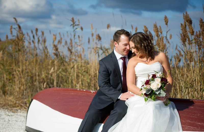 fall wedding with bride and groom on grounds at bonnet