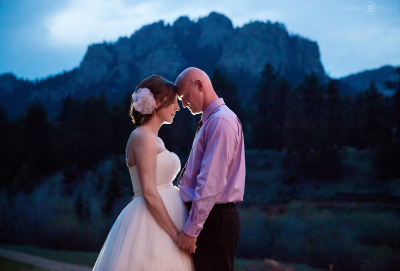 Pretty backlit couples portrait at dusk with Lions Head rock formation backdrop