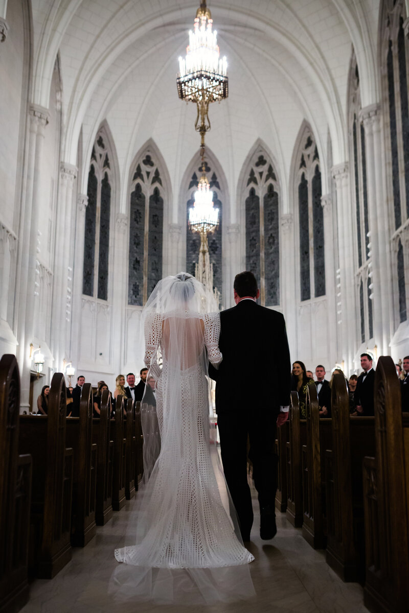 bride-going-down-aisle-st-james-chapel-chicago