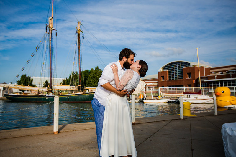 Bride and groom kiss outside of the Maritime Museum in Downtown Erie, PA