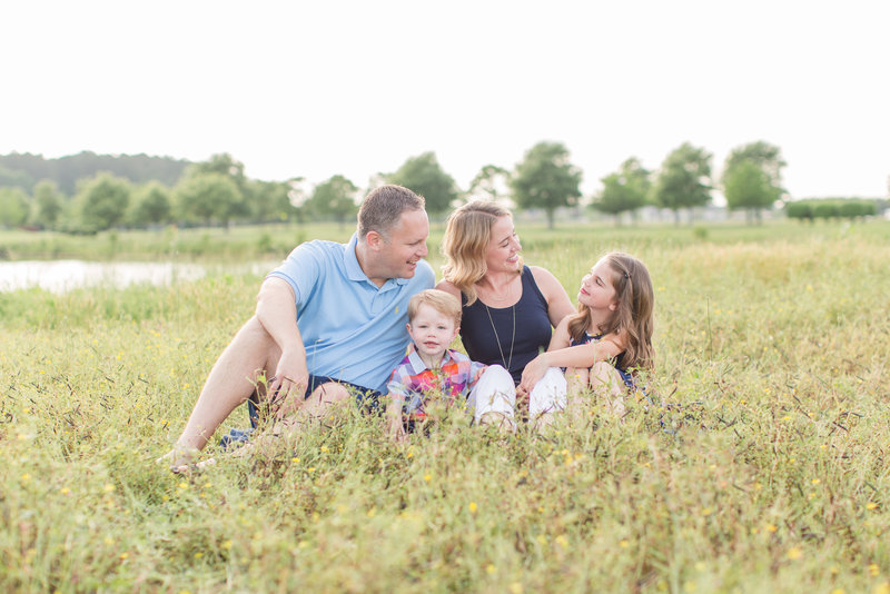 family sitting in a field