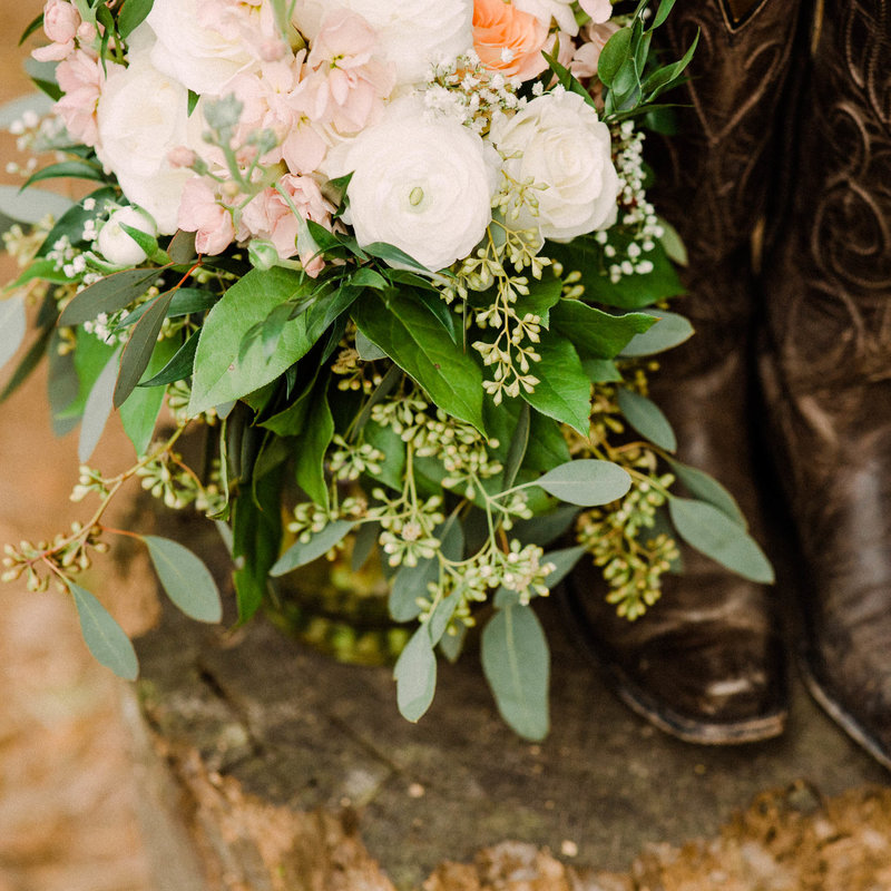 Wedding bouquet and cowgirl boots