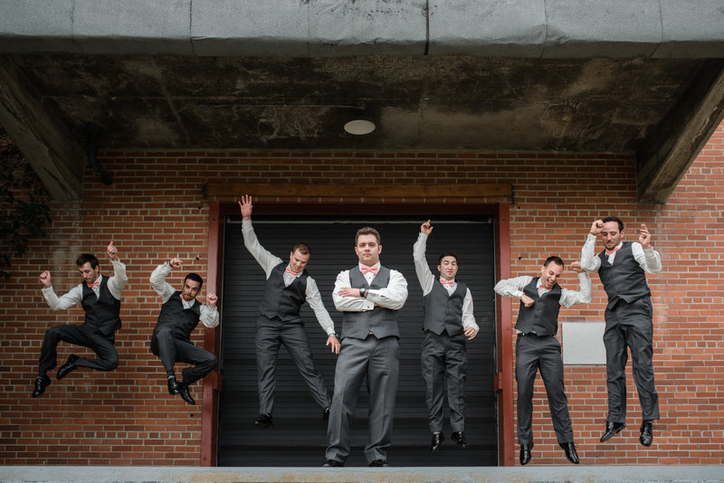 Red Deer Photographers-Raelene Schulmeister Photography- wedding photos-Groomsmen and Groom wedding photos in the rain-funny groomsmen photos-three piece suits for weddings
