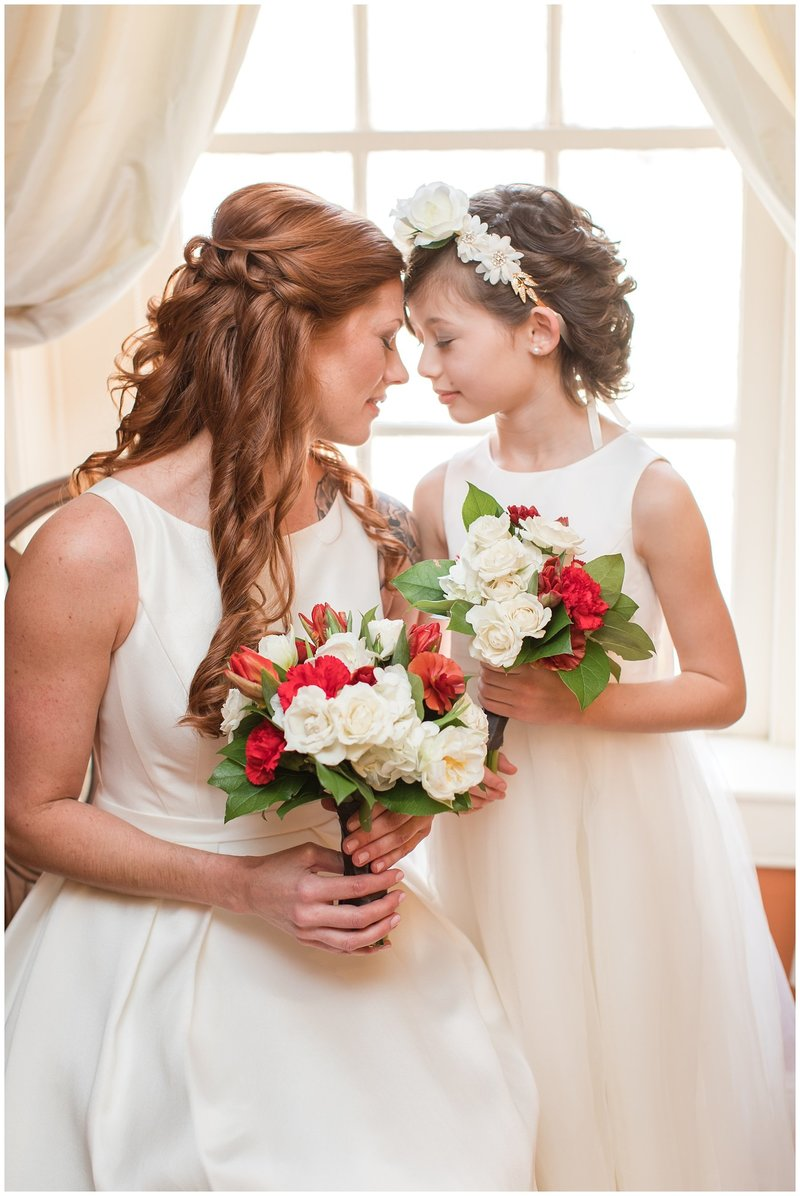Bride and flower girl dressed for a winter wedding at the Golden Horseshoe Inn wedding venue