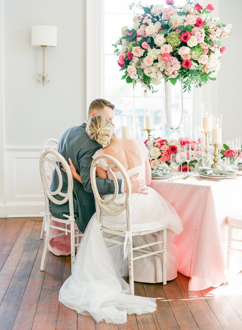 Bride and groom share a moment at their wedding at the gadsden House in charleston south carolina