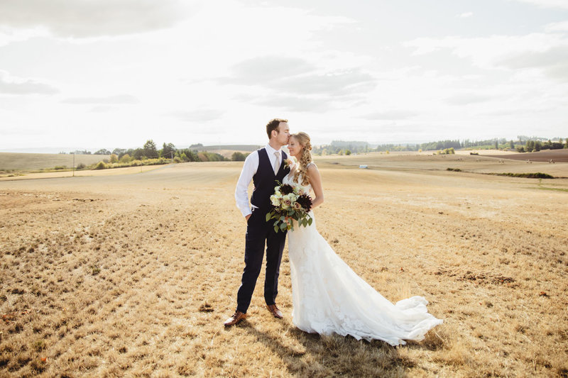 bride and groom in field at Union Hill Grange in Sublimity, Oregon
