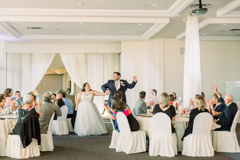 Elegant Skyline Country Club wedding reception photo of bride and groom introduction | Tucson Wedding Photographer | West End Photography