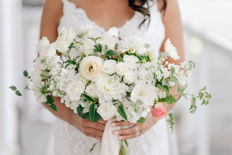 Bride holding white bouquet by Twisted Willow Floral during Lake Chelan elopement
