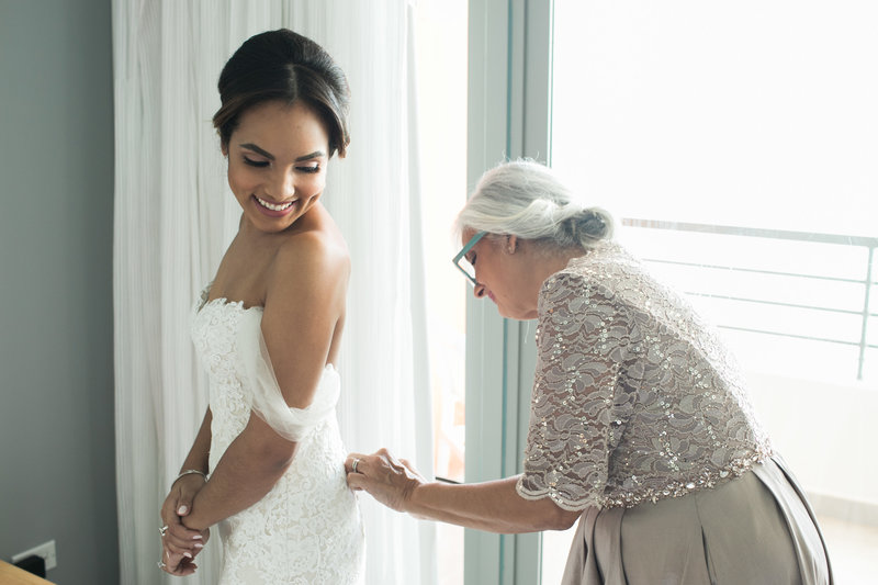 Bride gets dressed in La Concha San Juan Resort