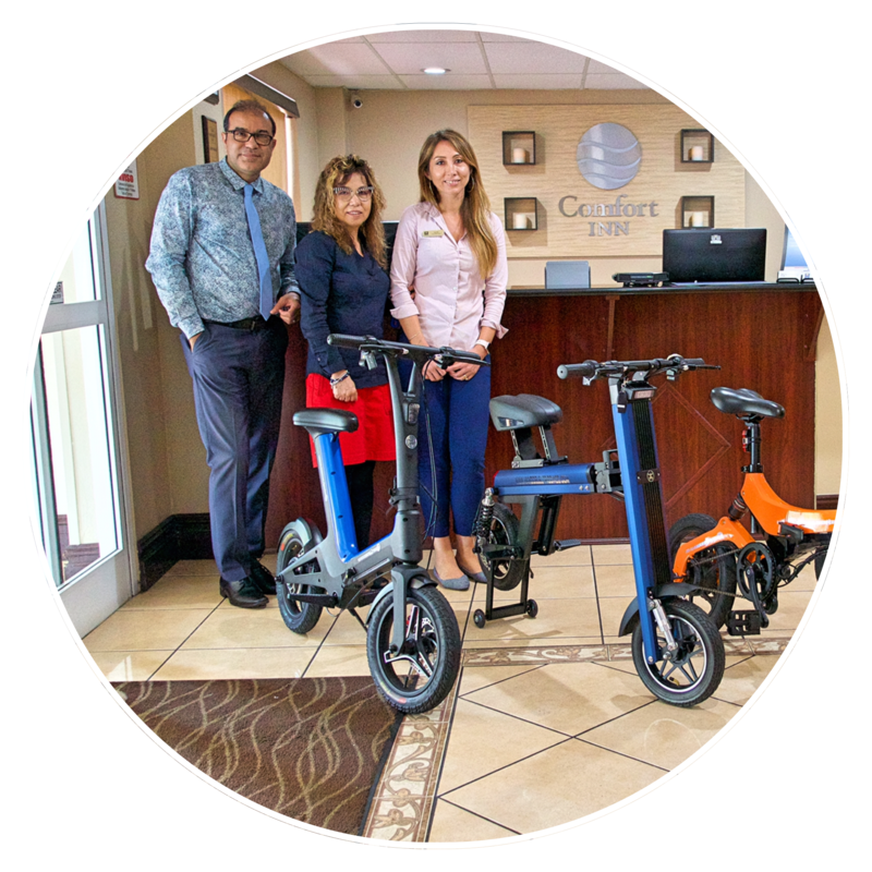 Comfort Inn renting Electric Foldable Bikes. Blue Go-Bike M3; Blue Go-Bike M2 and Orange Go-Bike M4. V&D Electric Bikes