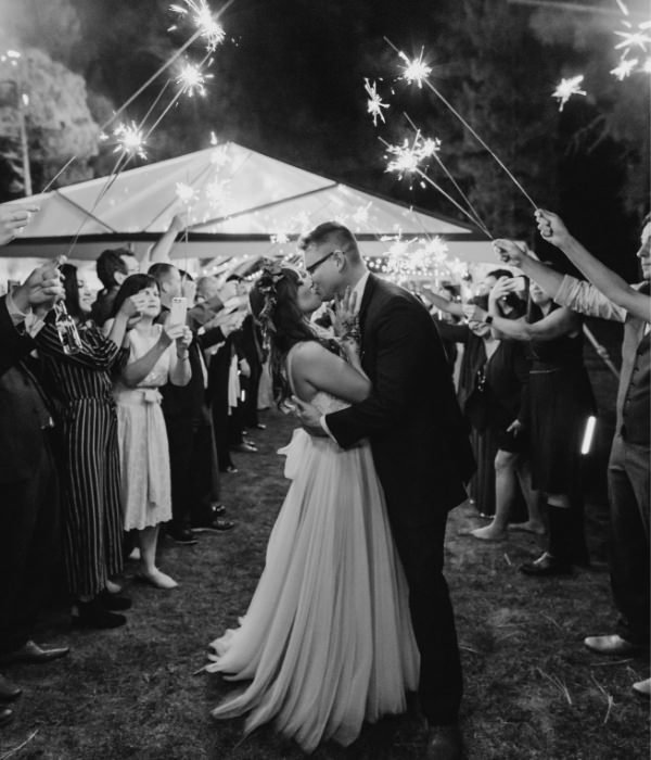 Joyful Lake Tahoe Wedding Planners couple kissing under sparklers, fall wedding at venue The Chalet View Lodge, Graeagle near Truckee, Joy of Life Events home page image by Nicole Leever Photography
