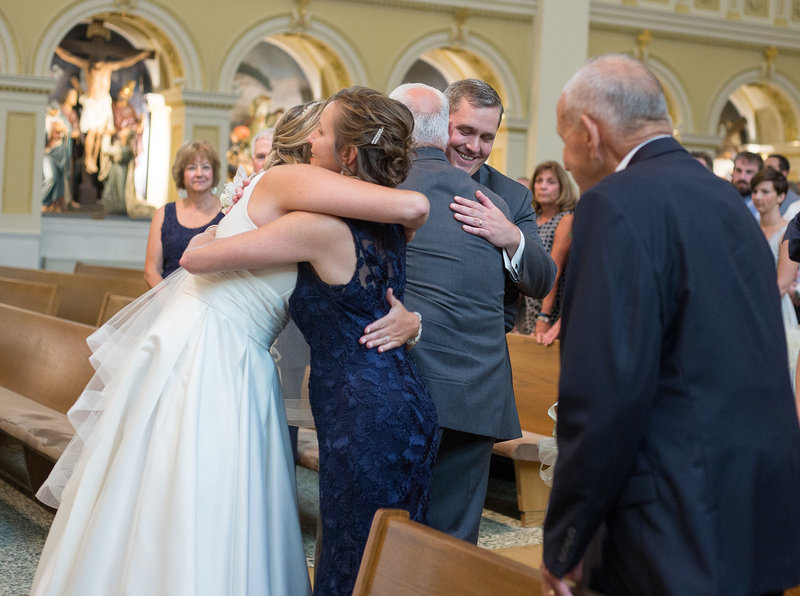 Bride hugs mother at St. Patrick's Church wedding