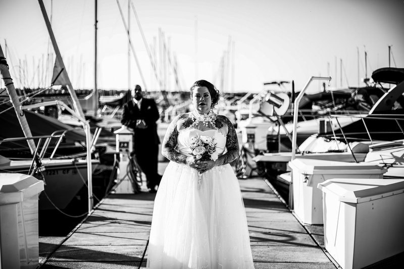 Groom watches bride from the transient dock at the Erie Yacht Club
