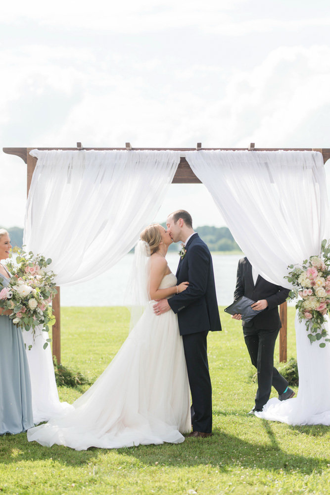 bride and groom first kiss at ceremony at eastern shore wedding at kirkland manor by costola photography