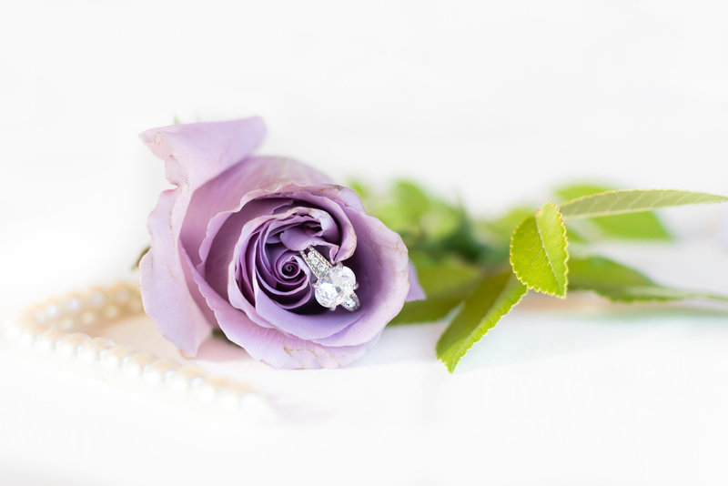 wedding ring in purple rose with pearls