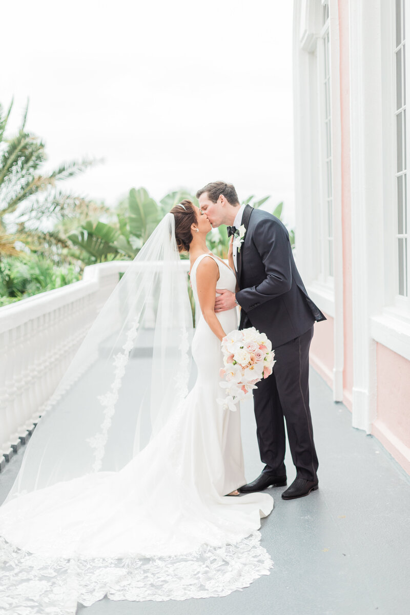 bride and groom kissing at Don Cesar wedding in St Petersburg Florida by Costola photography