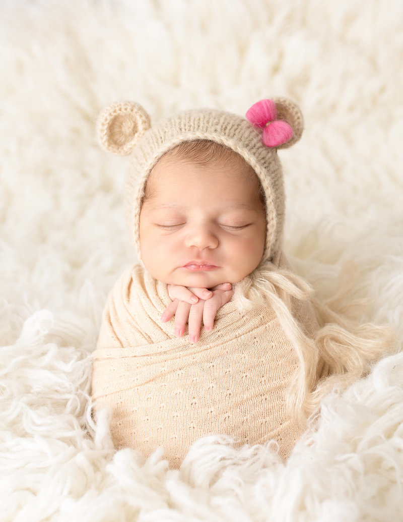 Adorable newborn girl posed at our Rochester, Ny studio.