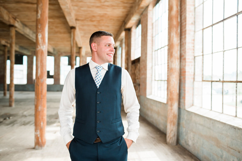Groom posing at McKinney Cotton Mill
