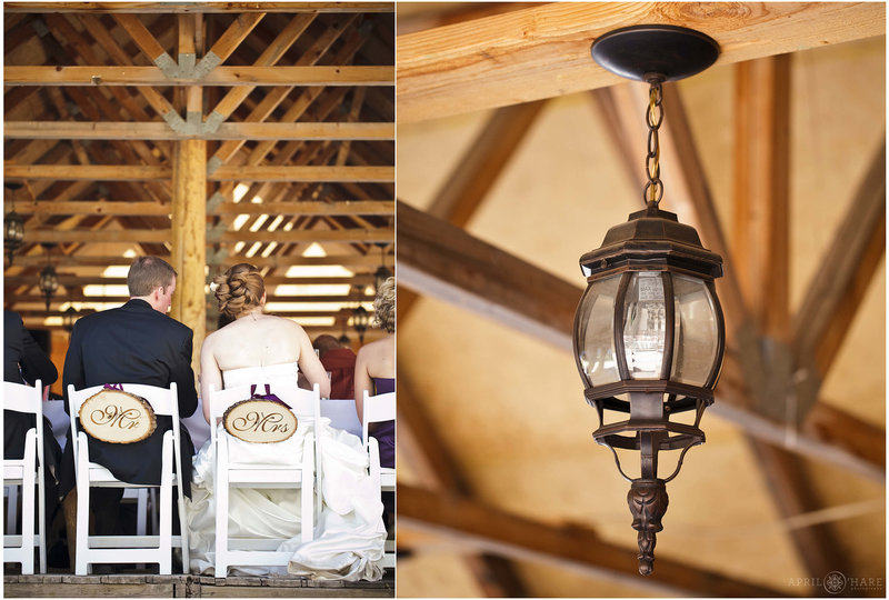 Rustic lantern hangs from outdoor Piney RIver Ranch wedding reception