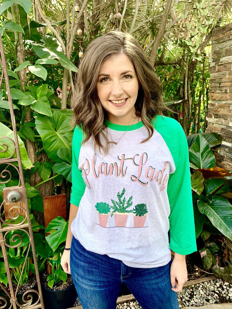 woman wears Plant Lady baseball tee