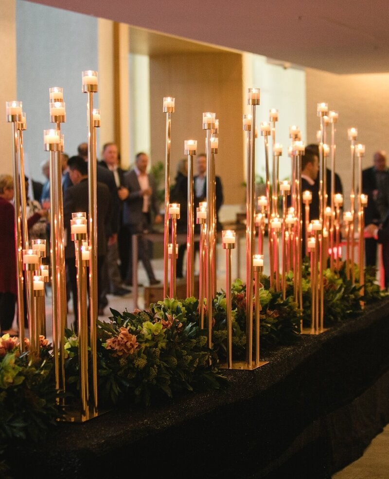 olive-green-gold-black-corporate-gala-dinner-candles-centrepiece