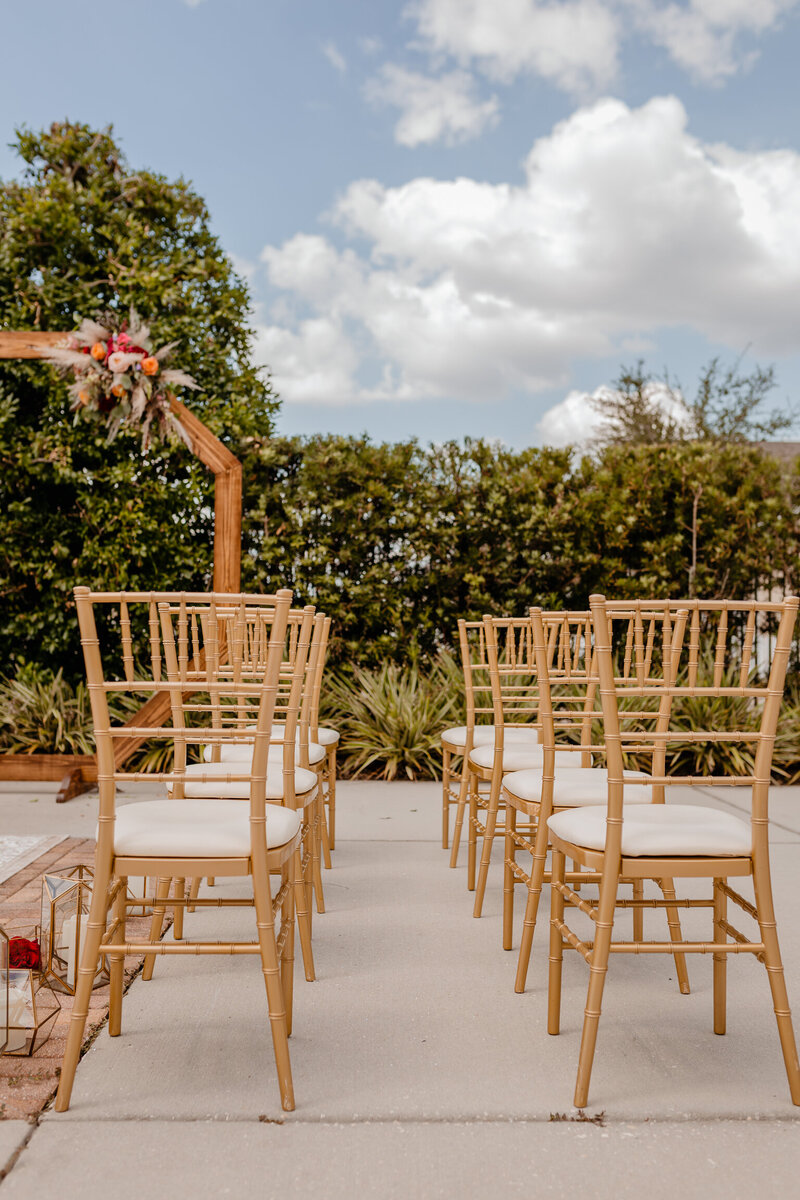 "alt=""gold chairs at wedding ceremony"""