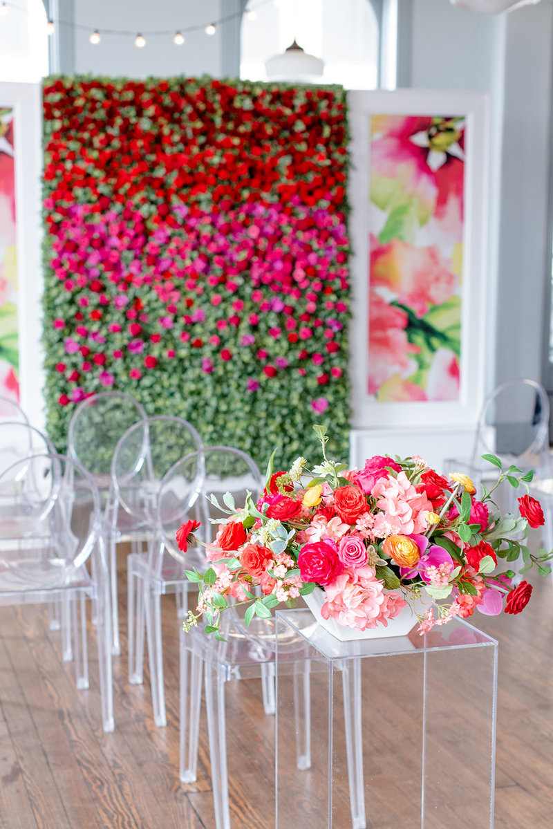 flower wall and ceremony arrangement