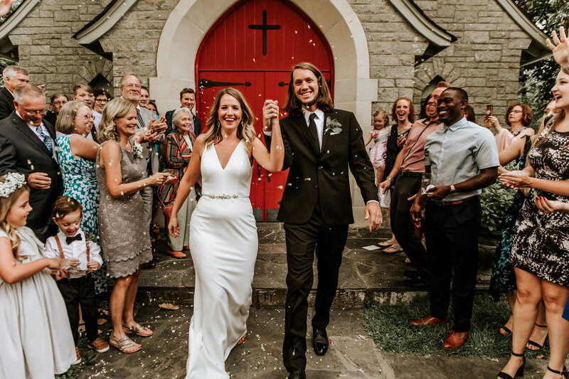 J.Michelle Photography captures a bride and groom leave the log cabin church in atlanta, ga after their wedding