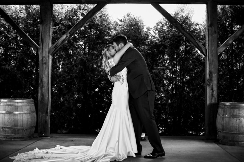 Bride and groom share first kiss at the end of their wedding at Quincy Cellars