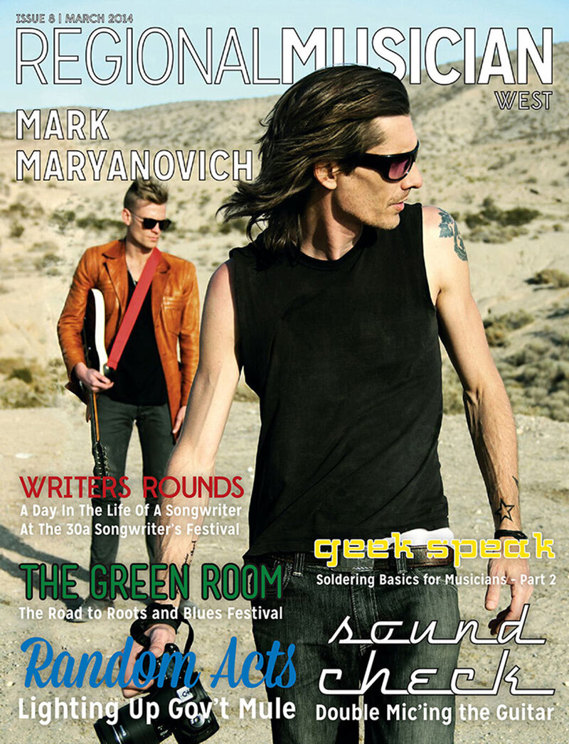 Magazine Cover featuring Mark Maryanovich Publication Regional Musician Mark walking in desert holding camera client in background