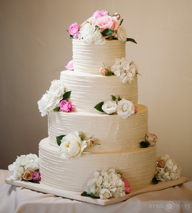 Four-Tier-White-Wedding-Cake-with-Florals-by-Blue-Moon-Bakery-in-Dillon-Colorado