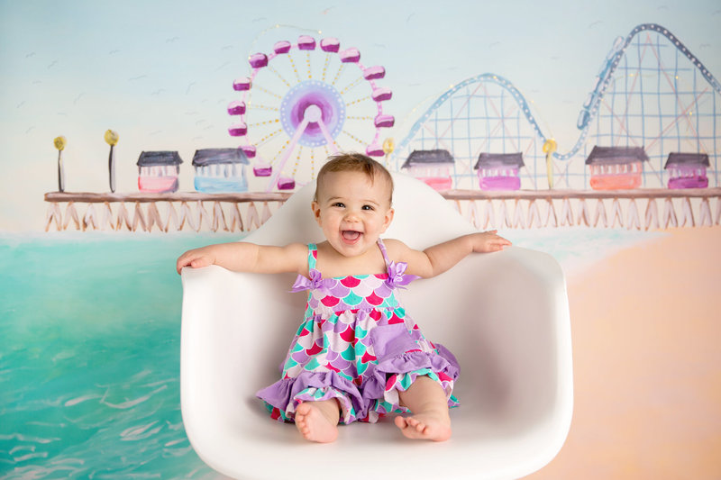 Baby girl on a beach pier backdrop