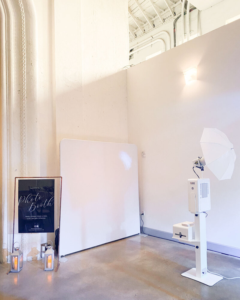 photo booth setup in all white at the rialto theatre in tampa, fl