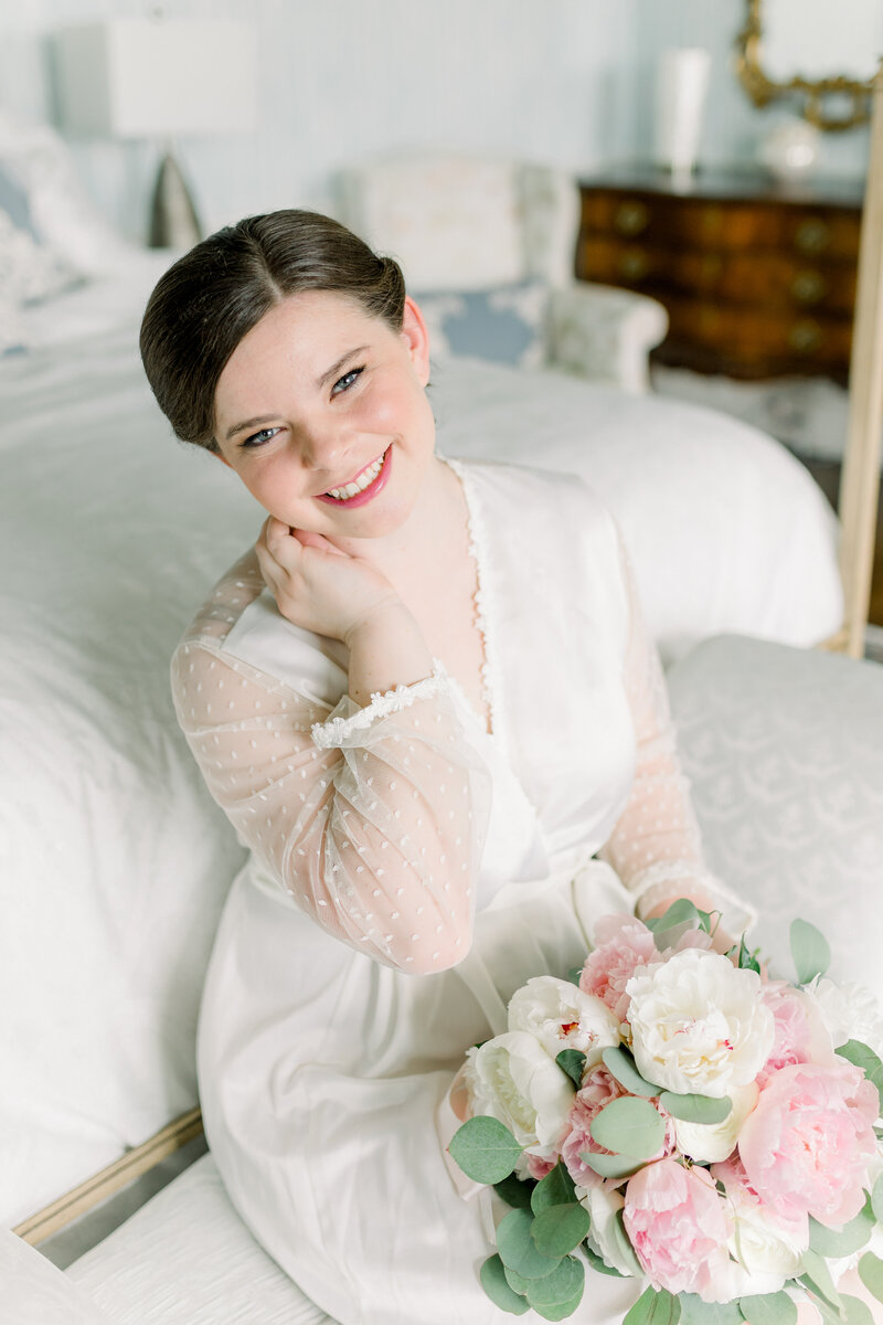 Virginia Wedding Photographer, bride sitting with her bouquet