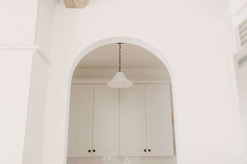 white arched doorway to pantry