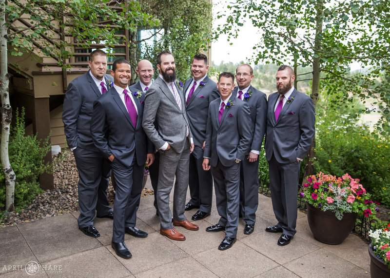 Groom with his friends gathered on the outdoor patio area at The Pines at Genesee