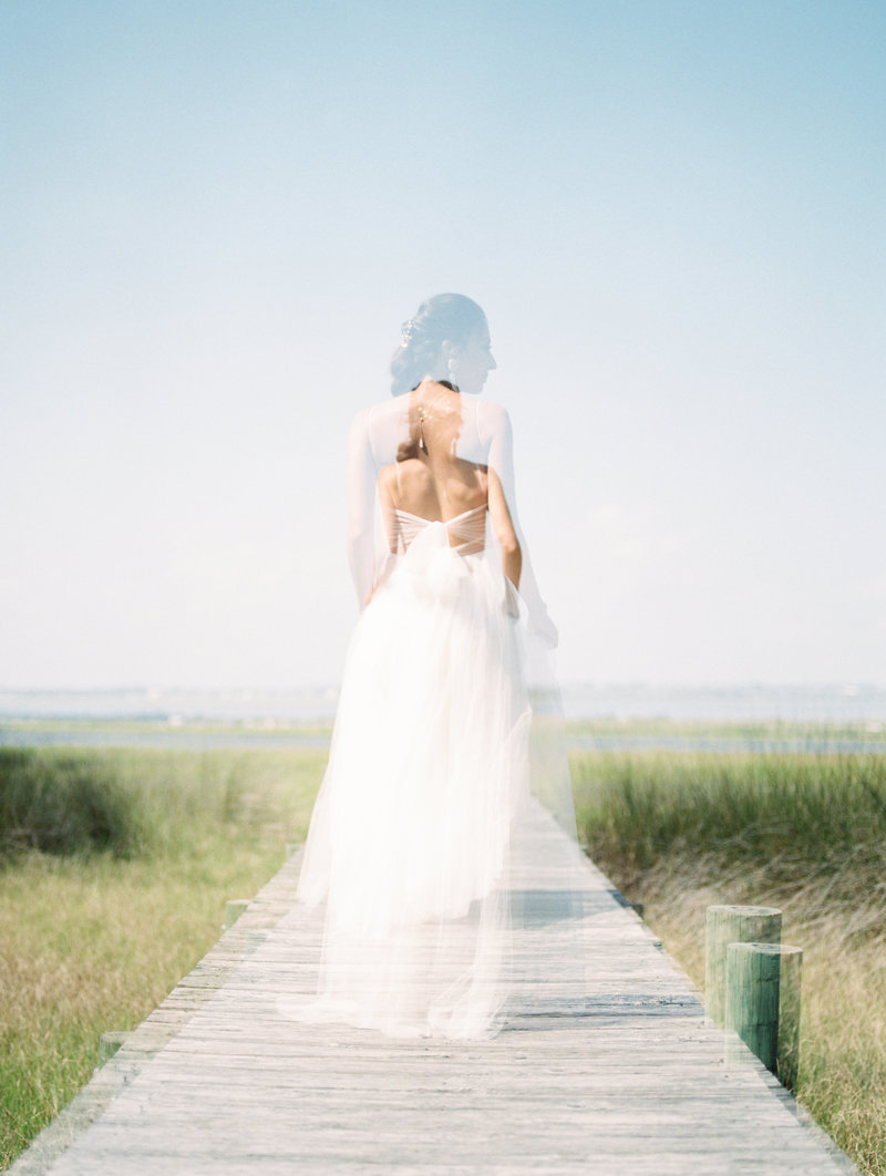bride walking down pier double exposure