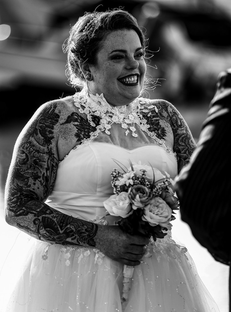 Bride smiling at groom during an Erie Yacht Club wedding