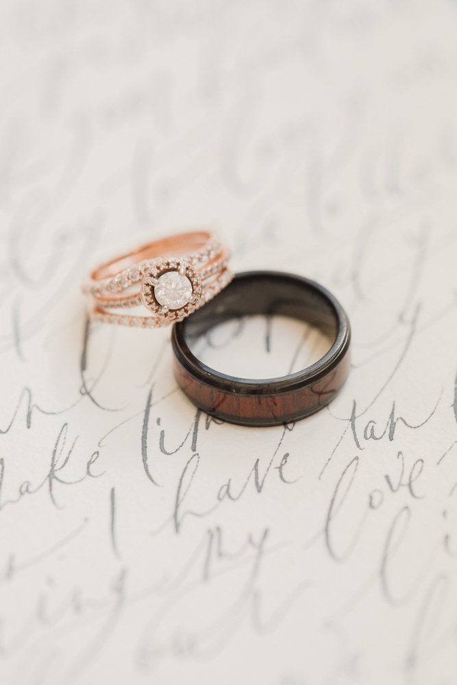 wedding rings on hand written vows at great marsh estate wedding in northern virginia by costola photography