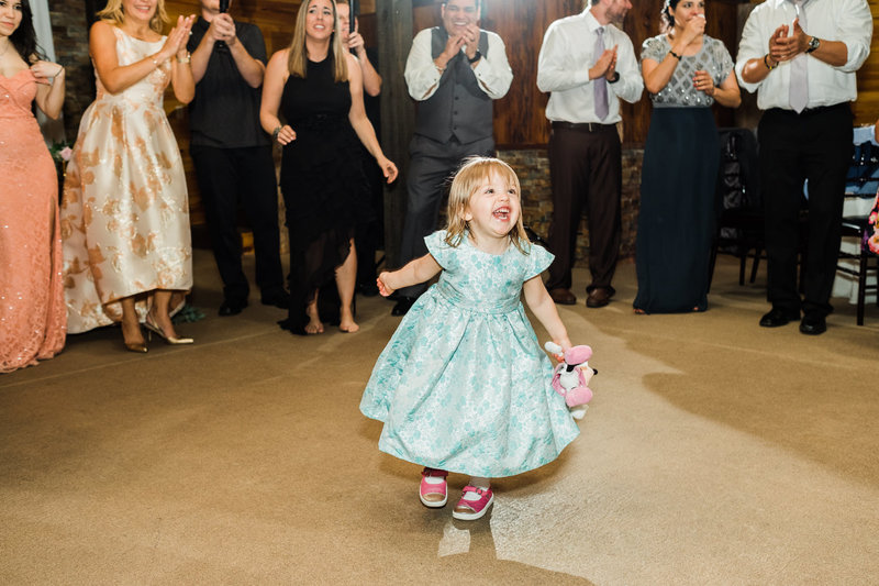 Cute little girl on the dance floor at Club Lake Plantation Wedding